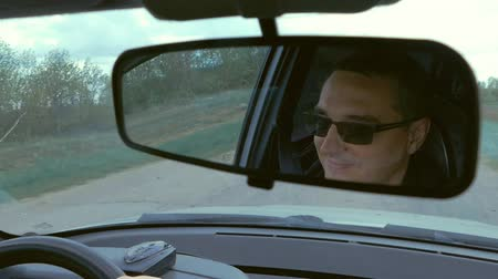 yansıma : a reflection of the driver in the car mirror slow-motion video