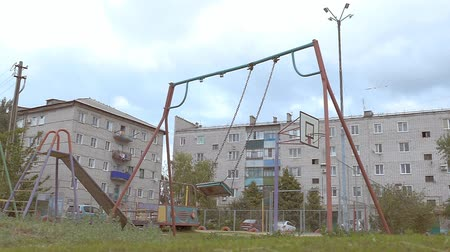 wasteful : swing swing on the playground Slow motion video