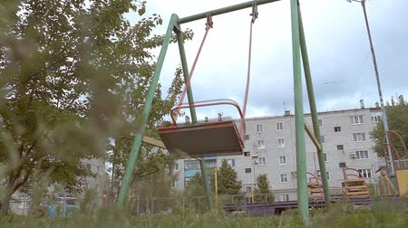wasteful : swing empty swing cloudy day slow-motion video Stock Footage