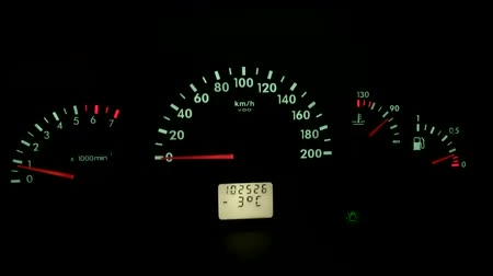 kilometer : speedometer of a car dashboard at night auto