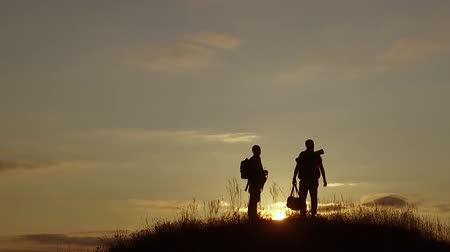 people tourists. people group of tourists walking on top of a travel sunset silhouette mountain. slow motion video tourists nature people group go Vídeos