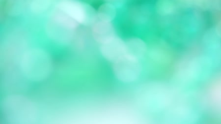 Defocused Blurred abstract green bokehbackground Стоковые видеозаписи