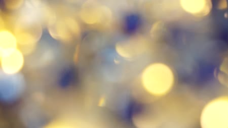 Blurred lights of Yellow and blue bokeh abstract color background