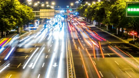multiple lane : Time lapse of busy freeway traffic at night in beijing city,china