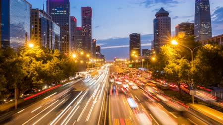 night scene : Time lapse of busy freeway traffic from day to night in beijing city,china