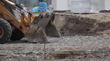 wheel loader : The excavator works on the construction site Stock Footage