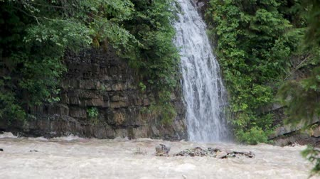 A small waterfall near Lake Synevir, which falls into a swift mountain river