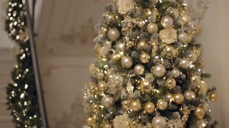 Medium tilt up shot of new year 2019 tree or christas tree with stairways with christmas decorations on background.