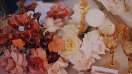 High angle shot of a beautiful wedding bouquet on the decirated dining table. Right to left. Middle shot.