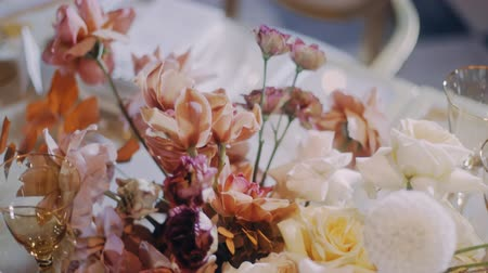 Crane up shot of beautiful wedding flowers with shallow depth of field.