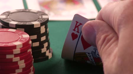 czarne : Close Up. Ace And King In His Hand. Poker Chips
