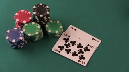 králové : Poker Player Shows Good Cards on The Poker Table. Raise chips and showdown.