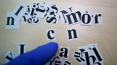 cant : Printed On Paper Letters Make up the Word I Can On Table. Paper Scraps Word I Can. Motivation Concept For Business, For Self Belief, Positive Attitude, Motivation Stock Footage