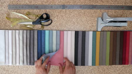 образец : Clothing Designer Or Tailor Choose Textile Textures Fabric Swatches. Choice of Fabrics Tissue Samplesfor Upholstery Or Clothing. Set Of Fabric Samples