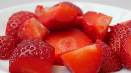 frutoso : Sliced Red Ripe Juicy Fresh Strawberry On A White Plate