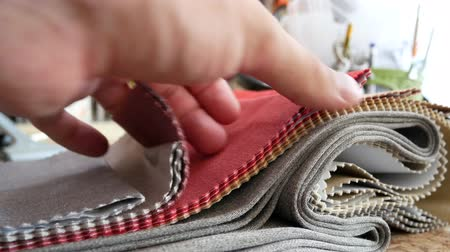 seçenekleri : Tissue Samples, Choice of Fabrics for Upholstery. Decorator Man Leafing Through Tissue Samples. Decorator Or Tailor Touching Textiles Textures Fabric Swatches Stok Video
