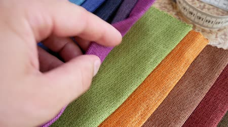 samples of fabric : Set Of Fabric Samples. Clothing Designer Or Tailor Working And Choose Textile Textures Fabric Swatches. Choice of Fabrics Tissue Samples for Upholstery Or Clothing Stock Footage