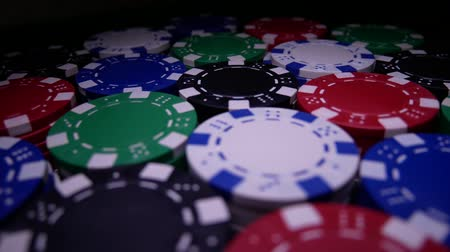 blackjack : Poker Table With Poker Chips Turns In Casino. Many Poker Chips Spins on the Table in Darkness