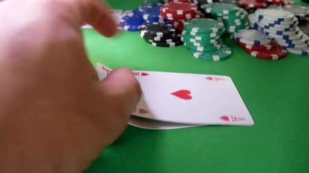 nervózní : Poker Player Moves Chips on Table at Casino. Casino Chips, Aces And King. Winner In Poker