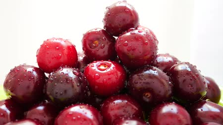 waterdrop : Group of Ripe Juicy Dark Red Cherry Rotates on White Background. Drops of Water on Fresh Cherry Berries. Pile of Cherry Fruit Pour Water. Rotating of Pile Wet Juicy Ripe Sweet Cherries With Waterdrop Stock Footage