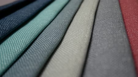 swatches : Fabric Samples Of Different Colors In Move Are Spinning And Rotation: Turquoise, White, Body Colors, Gray, Green, Blue, Black. Textile Textures Fabric Swatches Stock Footage