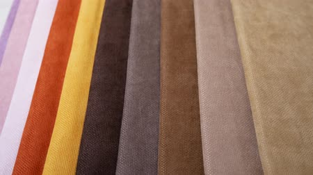color swatch : Fabric Samples Of Different Colors In Move Are Spinning And Rotation: White, Orange, Yellow, Brown, Gray. Textile Textures Fabric Swatches Stock Footage