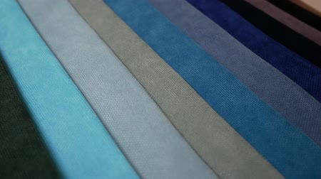 swatches : Fabric Samples Of Different Colors In Move Are Spinning And Rotation: Blue, Turquoise, Black, Body Colors, Gray. Textile Textures Fabric Swatches Stock Footage