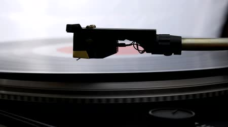 rock album : Spinning Record Player With Vintage Vinyl. Turntable Player And Vinyl Record With Dropping Stylus Needle Running Old CD And Playing Music on White Background