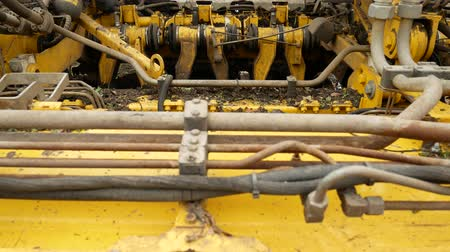 hydraulic : Detail of tractor combine harvester for harvest sugar beets on field farm
