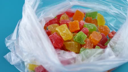 kandovaný : Candy Mix rotates plate with colorful cubes candied fruit. Turkish Delight Colorful Sweet Candy Delicious Concept as Background rotate