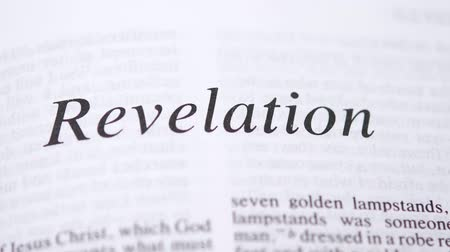 bible study : Reading Revelation in Holy Bible on sunday readings Stock Footage