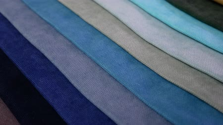 color swatch : Collection of textile samples are spinning or rotation. Multicolor fabric texture background Stock Footage
