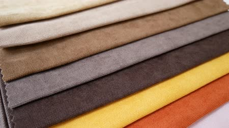 cortinas : Colorful fabric samples are spinning or rotation Vídeos