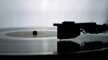 gramophone : Spinning Record Player With Vintage Vinyl. Turntable Player And Vinyl Record With Dropping Stylus Needle Running Old CD And Playing Music on White Background