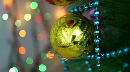 bombki : Yellow baubles on Christmas tree. Christmas and New Year Decoration. Abstract Blurred Bokeh Holiday Background. Blinking Garland. Christmas Tree Lights Twinkling