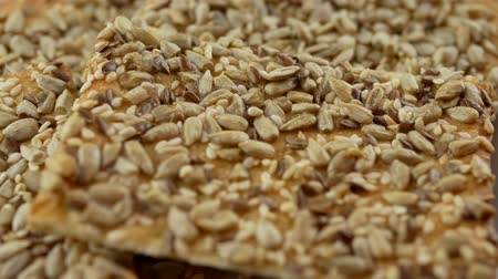 grated : Vegan crunchy cookies with sunflower, flax seeds and sesame seeds isolated on white background. Close up view