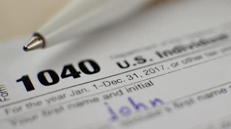 refund : US Individual Income Tax Return Form 1040 with Pen in 2017