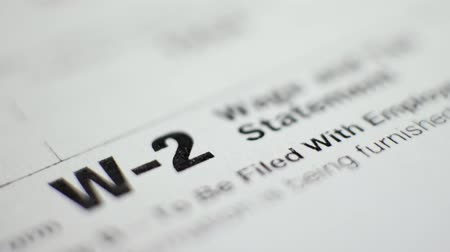 refund : W-2 Tax Form with Pen in 2017 Stock Footage