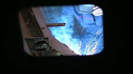 argon : Worker in protection mask are welding iron at plant