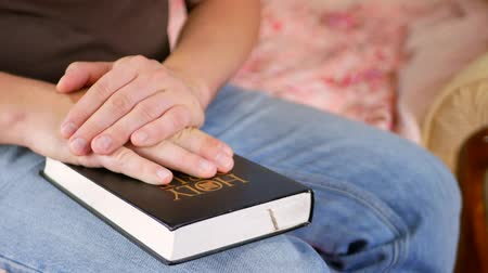 holy book : Man praying with Holy Bible at home