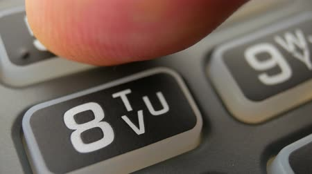 читатель : Finger entering the PIN code at payment terminal