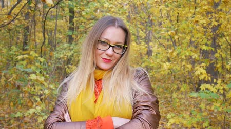 empresárias : Portrait of beautiful woman wearing yellow glasses at park in autumn with colorful leaves and trees background