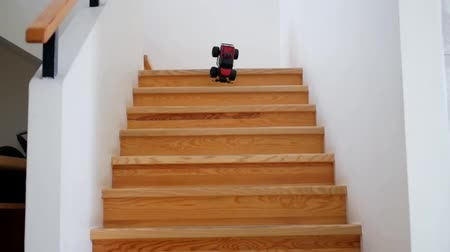 alıcı : Remote controlled toy car falls from wooden steps