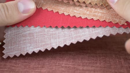 katalog : Fashion designer is working with fabric samples of different colors. Textile textures fabric swatches concept