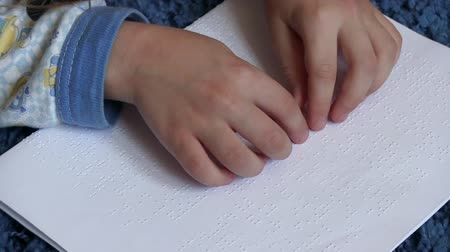 blindness : Child learning Braille alphabet at school