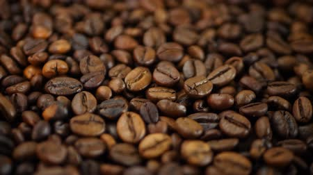 brew coffee : Roasted brown coffee beans group rotates Stock Footage