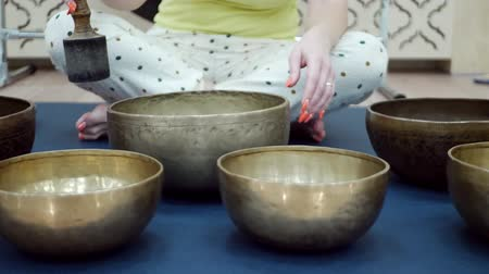 himalayan : Woman with tibetan singing bowl. Music therapists, sound healers and yoga practitioner concept