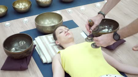 karma yoga : Woman practicing yoga meditation with tibetan singing bowl