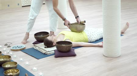 gong : Struck and singing bowls are widely used for music making, meditation relaxation, as well for personal spirituality. Music therapists, sound healers and yoga practitioner concept