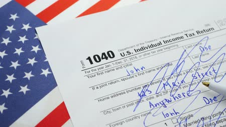 raport : American 1040 Individual Income Tax return form. Depressed and stressed or troubles during filing Tax Forms concept